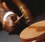 Hand bringing down gavel - Colorado Criminal Defense Attorney