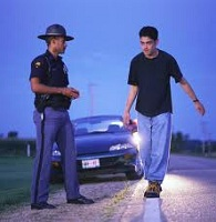 State Trooper Giving Young Adult Sobriety Test - DUI Attorney Boulder CO