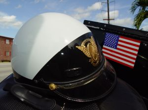 Police helmet on top of a police motorcycle with an american flag sticker