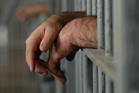 Hands stick out of jail cell
