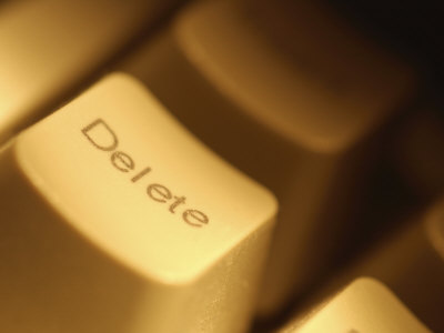 Keyboard Delete Button Close Up in Tan Light