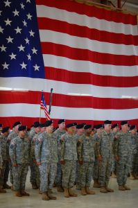 Army Soldiers Standing in Front of USA Flag