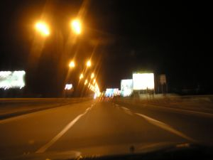 Road lit with streetlights at night
