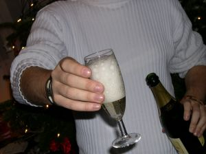 Person in a white sweater handing a cocktail to someone else