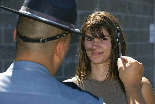 image of young woman being given field sobriety test - follow the pen with your eyes.