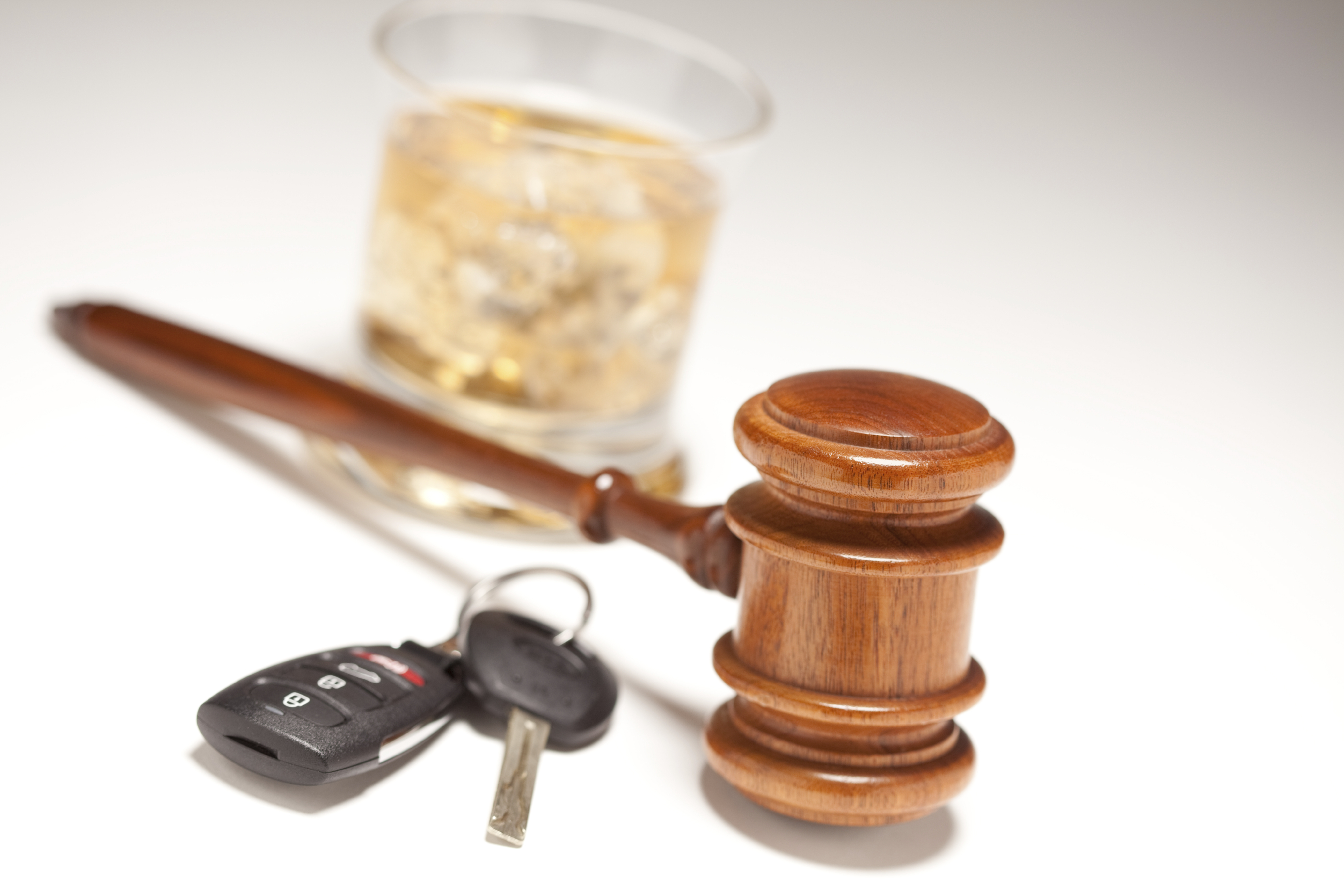 Gavel, Alcoholic Drink, Car Keys on a Gradated Background - Drinking and Driving Concept.