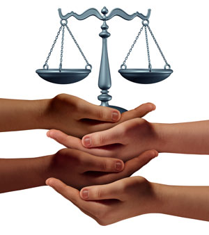 image of group of hands representing diverse groups of people cooperating together to provide law, justice, and reform and treatment information and support and advice holding a justice scale.